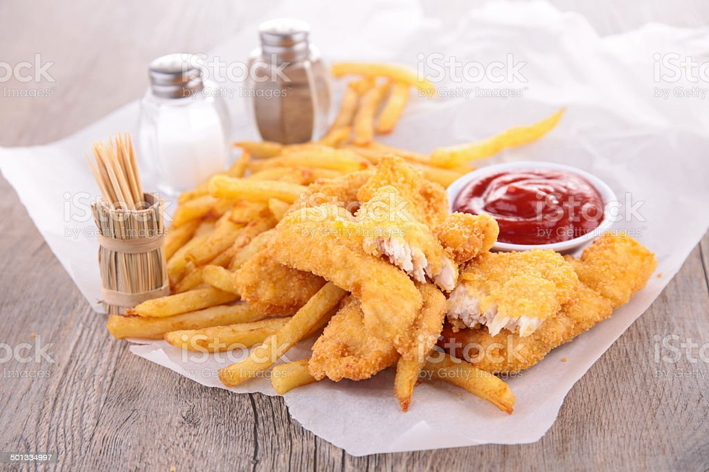 french fries and fried chicken nuggets stock photo