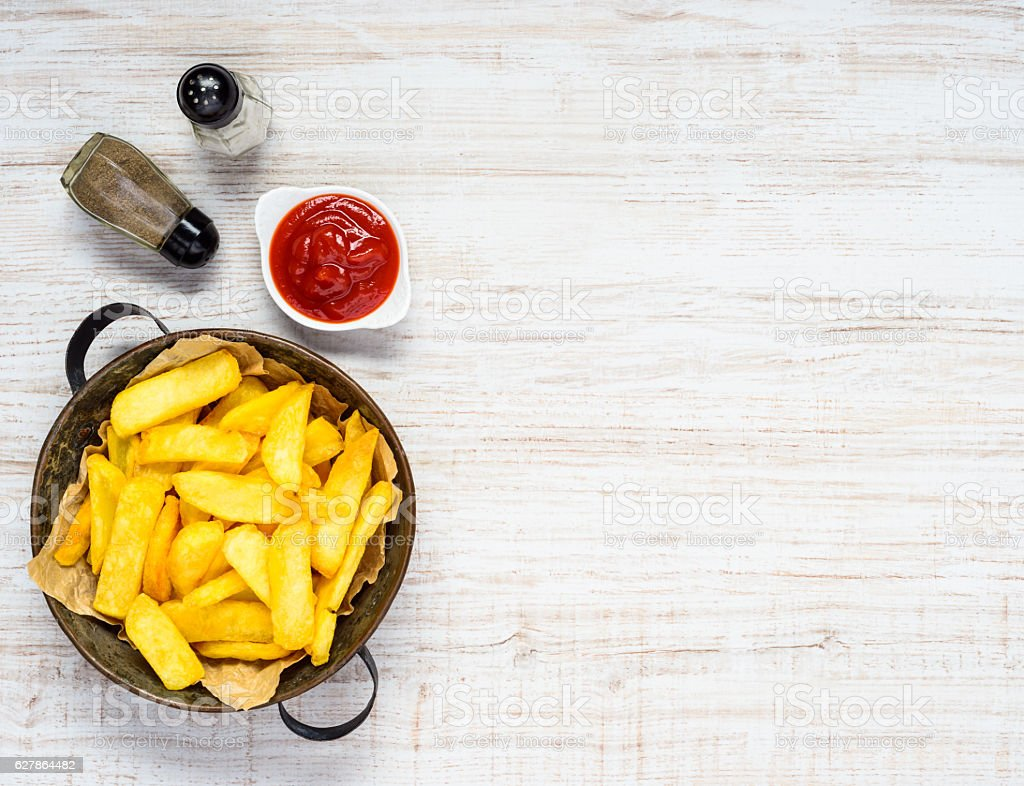 French Fries and Ketchup on Copy Space Text Area stock photo