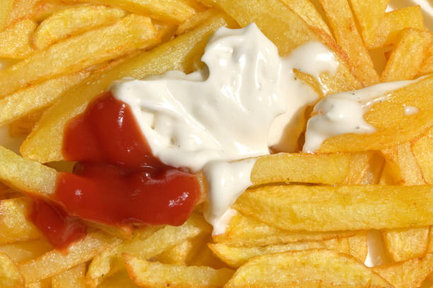 French Fries and Tomato, White Sauce, Mayonnaise French Fries and Tomato, White Sauce, Mayonnaise patatine fritte stock pictures, royalty-free photos & images