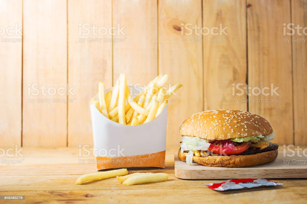 French fries , Burger,Fast Food on a Wooden Chopping Board stock photo