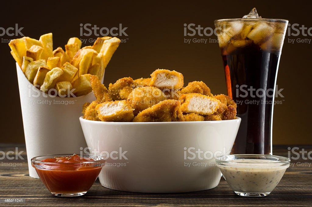 French fries chicken nuggets and cola royalty-free stock photo