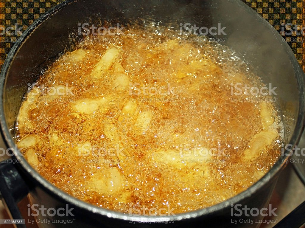French Fries Cooking In Deep Fryer stock photo