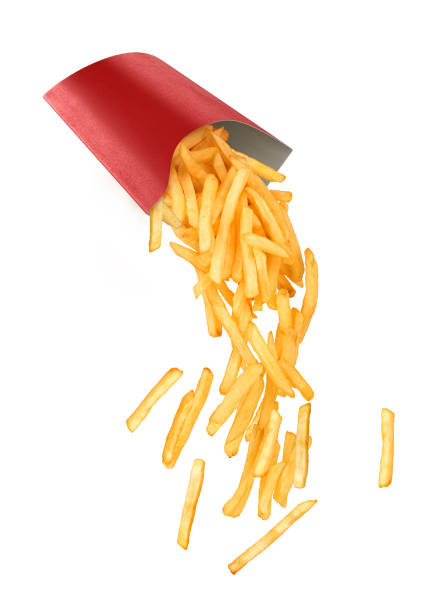 French fries fall out of a paper cup French fries fall out of a paper cup patatine fritte stock pictures, royalty-free photos & images