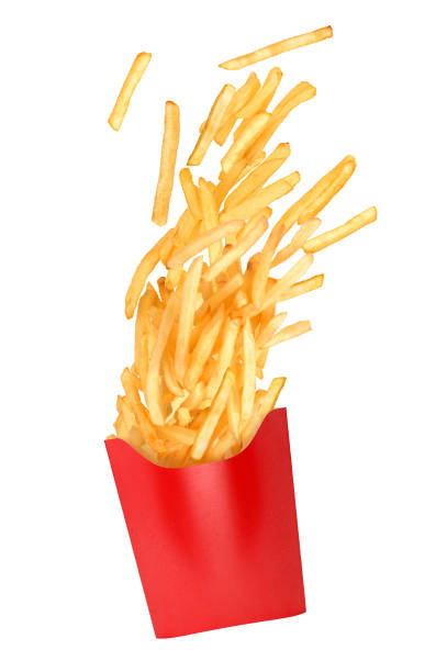 french fries flies out in a paper cup french fries flies out in a paper cup patatine fritte stock pictures, royalty-free photos & images