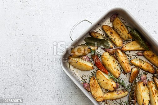 French fries golden and crunchy. With aromatic herbs. Flat lay.
