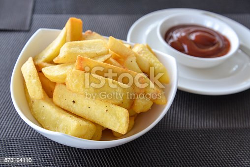 French fries in a bowl on a table