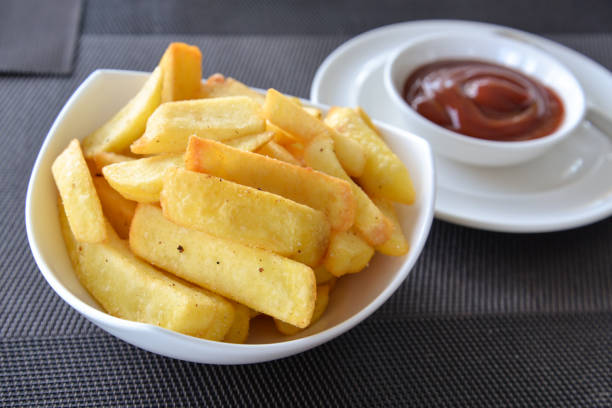 french fries in a bowl on a table - thick stock pictures, royalty-free photos & images