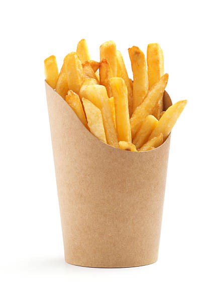 french fries in a paper wrapper stock photo