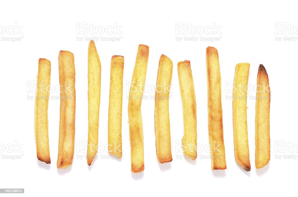 French fries in a row on white background stock photo