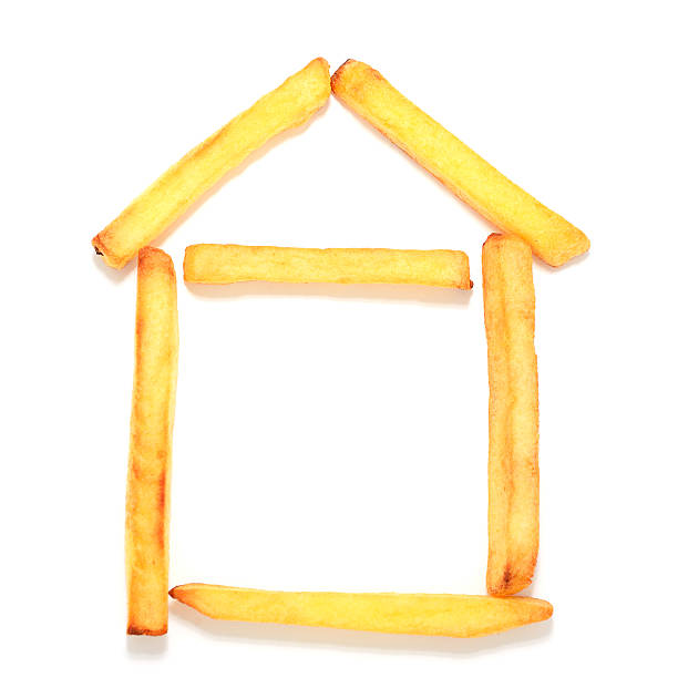 French fries layout for a house on white background stock photo