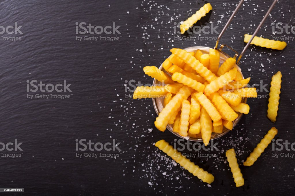 French fries on dark background