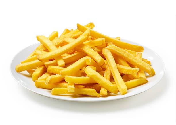patatine fritte su un piatto - patatine foto e immagini stock