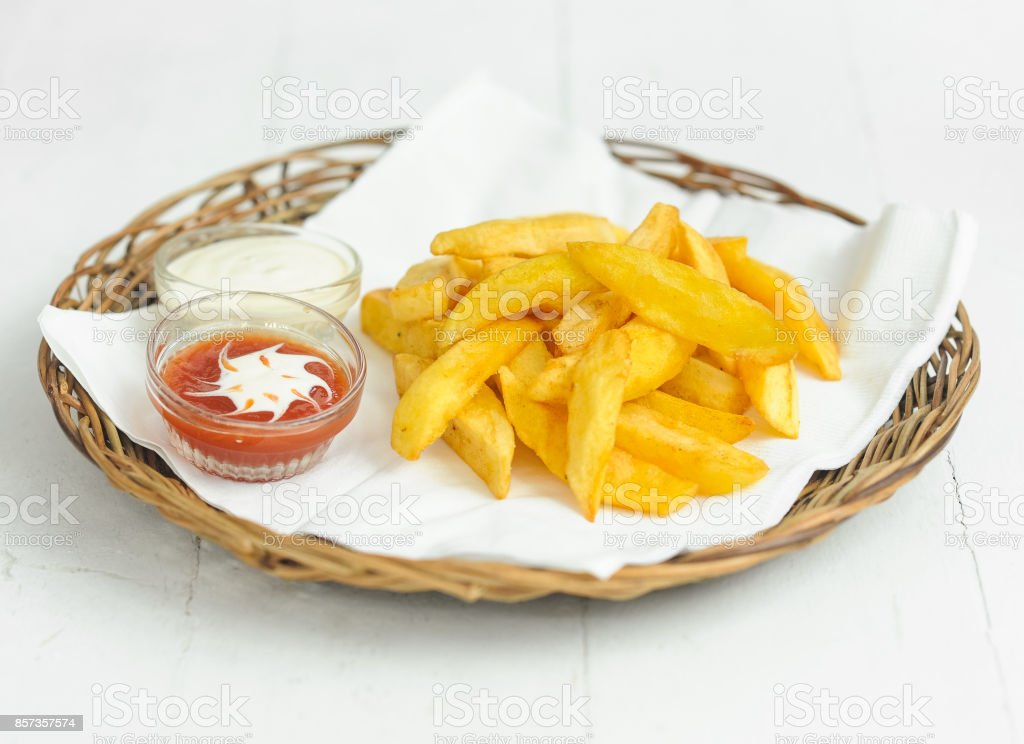 French fries on the rattan plate stock photo