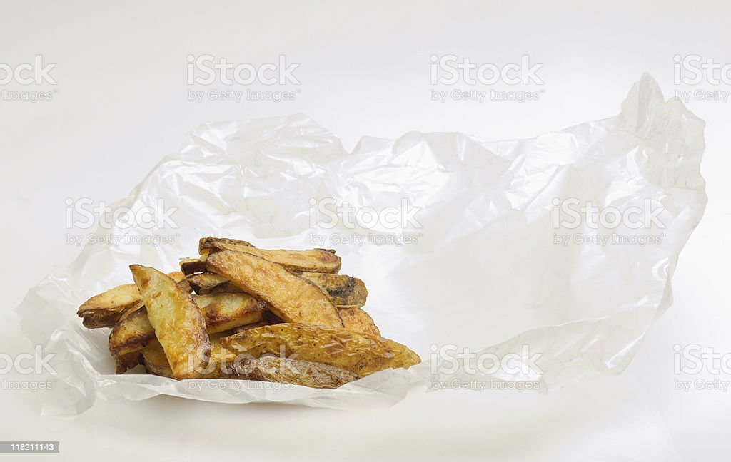 French fries on wax paper stock photo