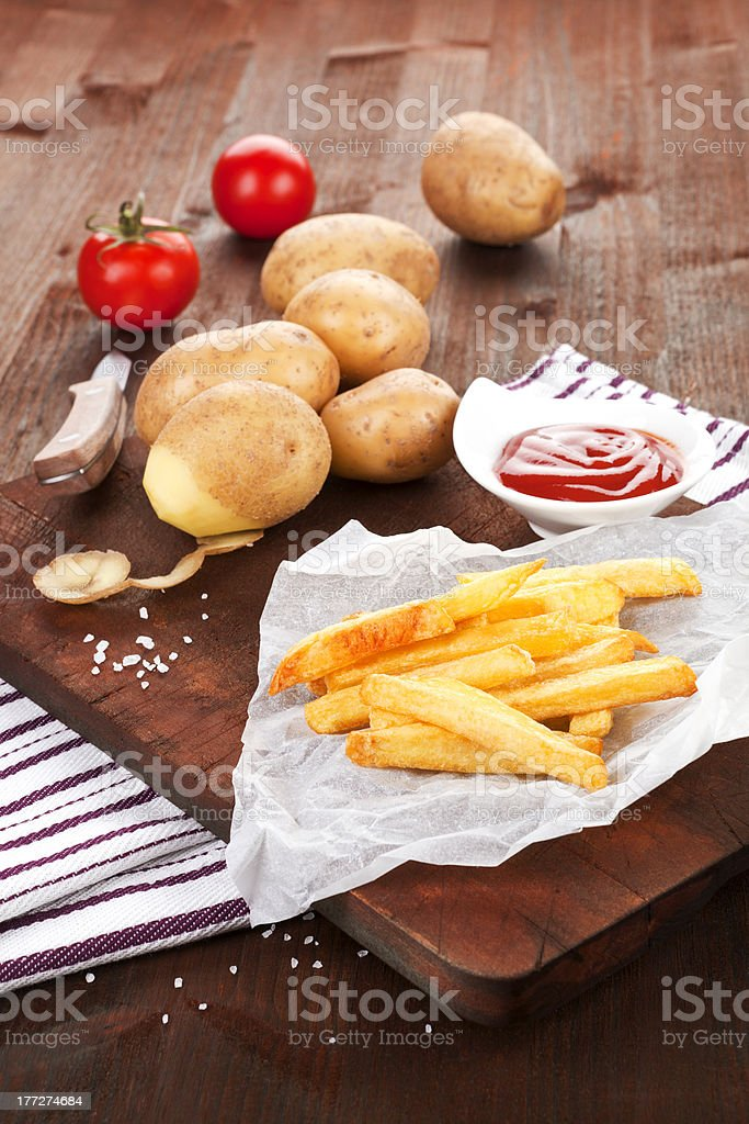 French fries rustic background. royalty-free stock photo