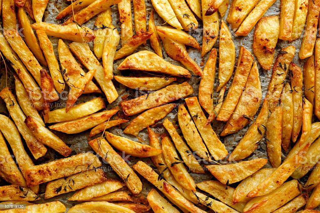 French fries with addition herbs stock photo
