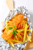 French fries with schnitzel in tinfoil