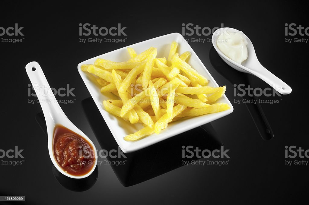 French fries with tomato sauce and mayonnaise royalty-free stock photo