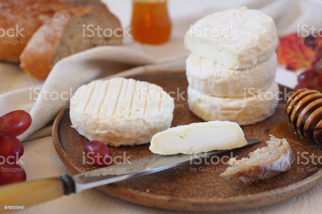 French goat cheese, honey, red grape and bread stock photo