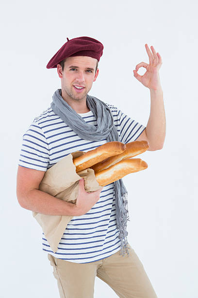 French guy with beret holding baguettes stock photo