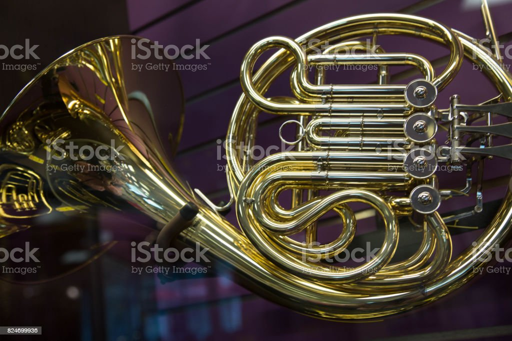 French horn closeup purple background stock photo