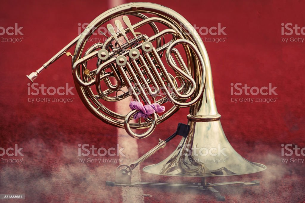 French Horn waiting its turn to perform in the performance stock photo