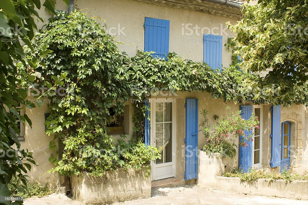 French House with colored window shutters France. Provence royalty-free stock photo