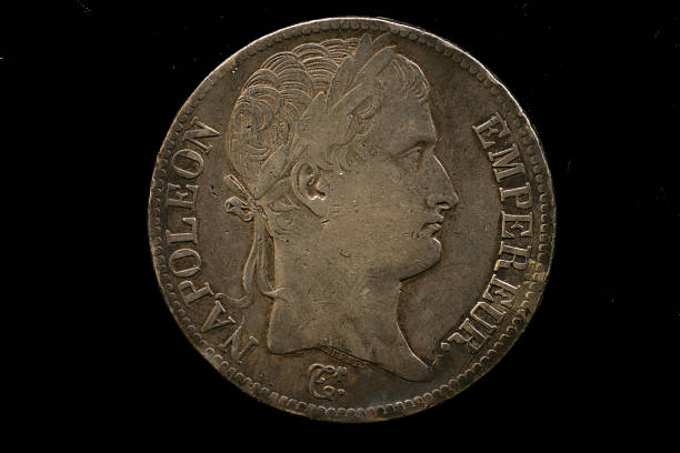 French Imperial Coin Isolated On A Black Background stock photo