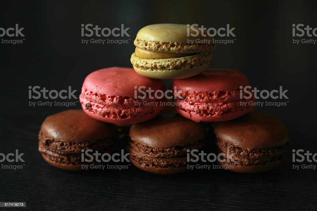 French macarons on a black background stock photo