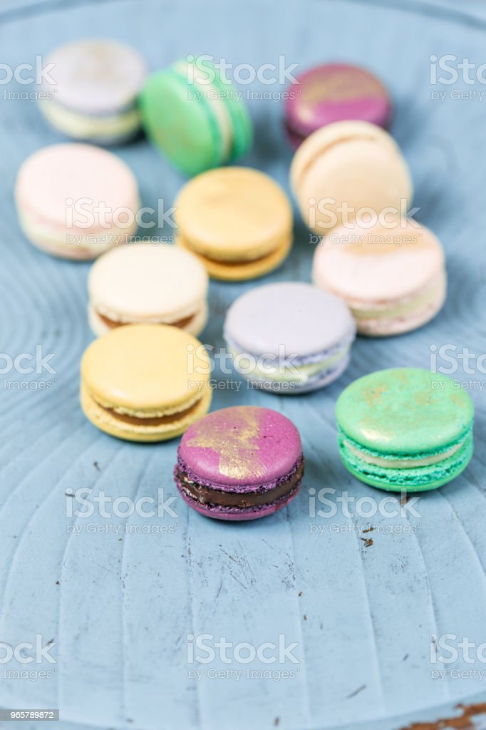 French macaroon dessert and flowers eucalyptus on a turquoise background. pastel colors - Royalty-free Almond Stock Photo