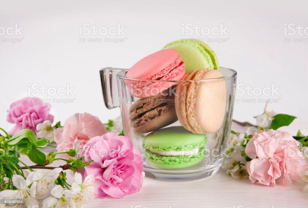 French macaroons in cup. with spring flowers. royalty-free stock photo