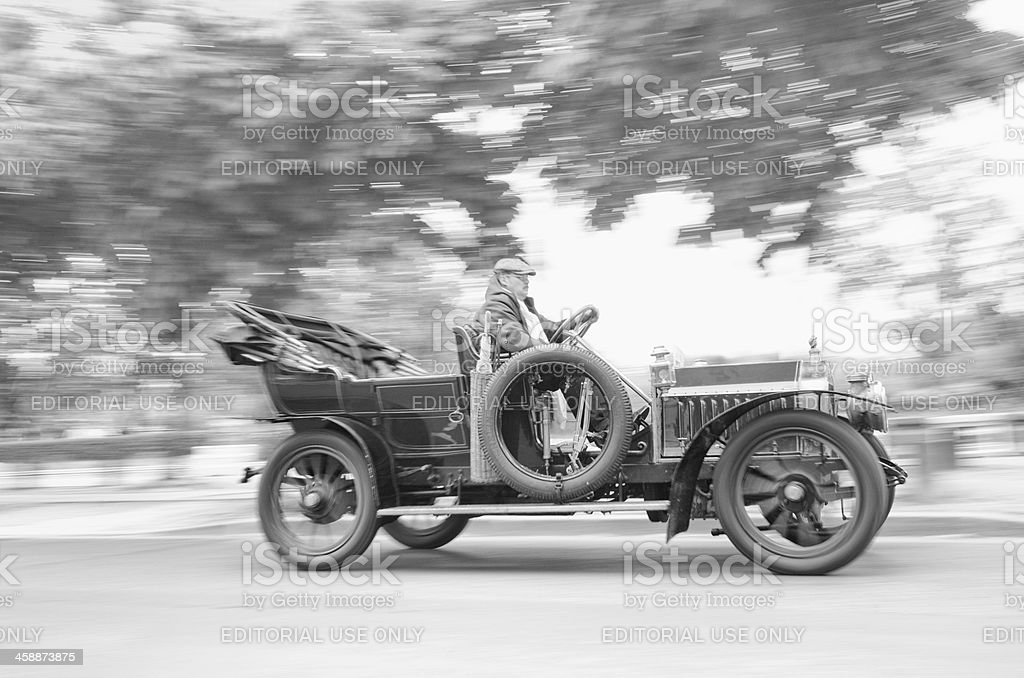 French Man Driving Antique Classic Car in Paris France stock photo