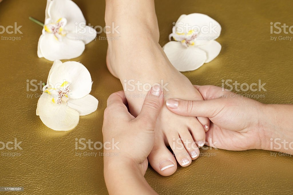 French manicure on golden leather stock photo