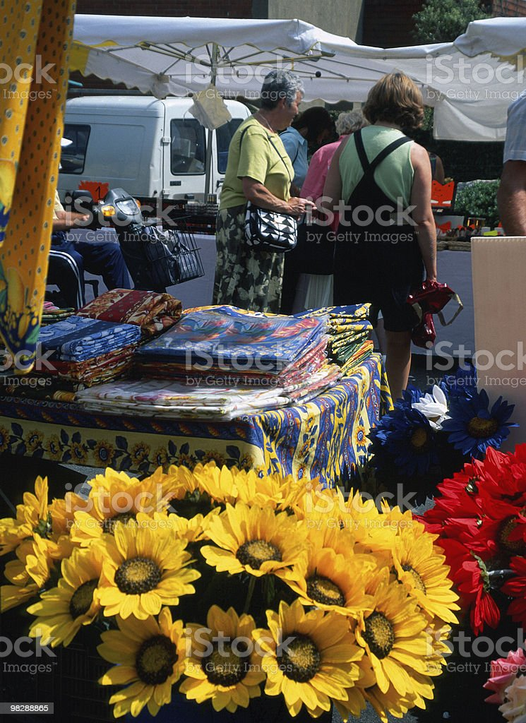 French Market Stall.Artificial Flowers and Tableclothes royalty-free stock photo