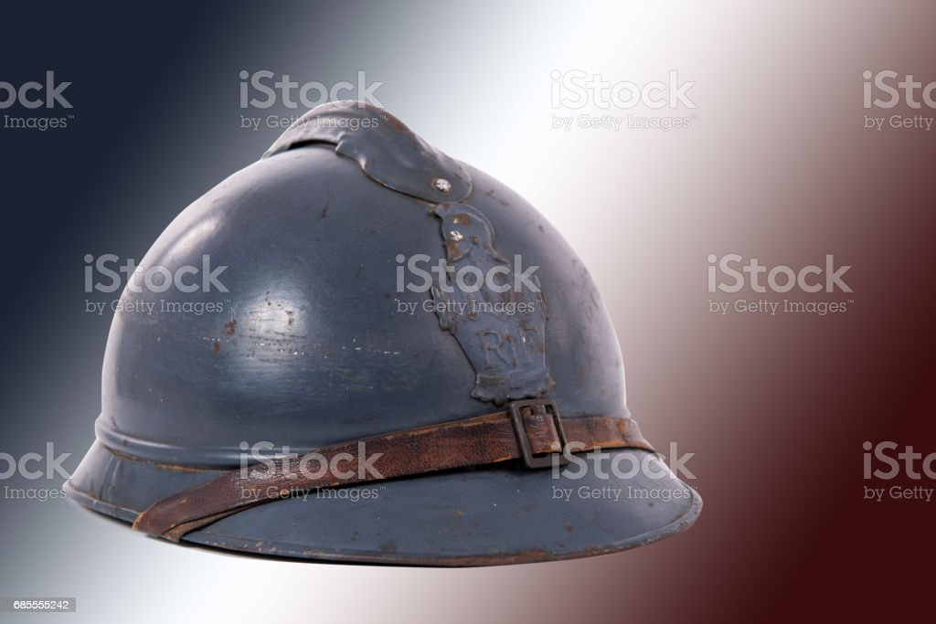 french military helmet of the First World War on red white blue flag stock photo