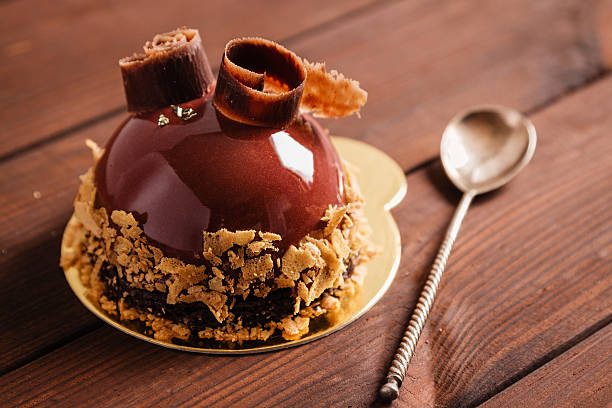 French mousse cake covered with chocolate glaze