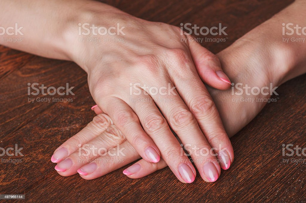 French Nail Art In Light Pink Colour On Wooden Background Stock ...