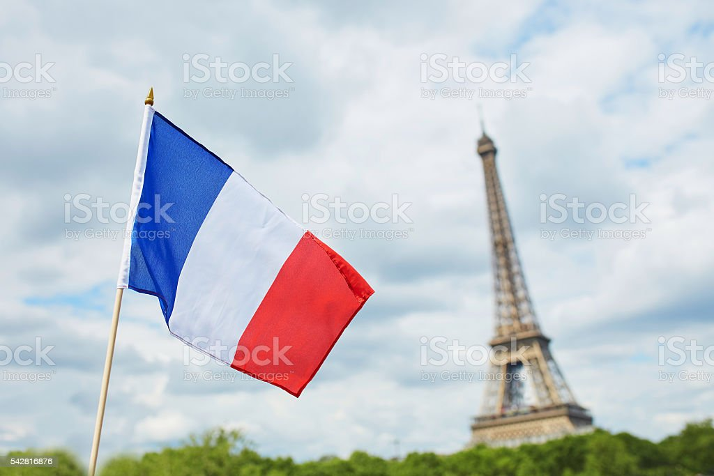 French national flag in Paris with the Eiffel tower stock photo