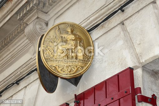 845085240istockphoto French office notary plate hanging on the street 1082323192