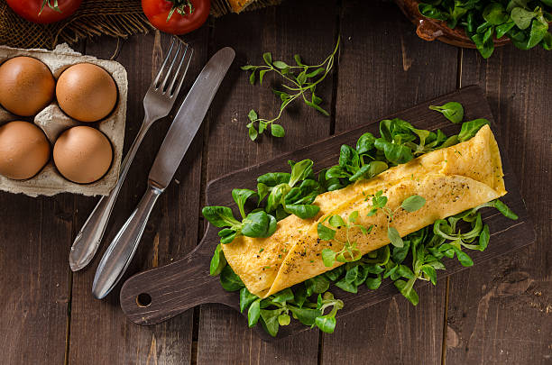 French omelet, fluffy, fresh eggs and herbs stock photo