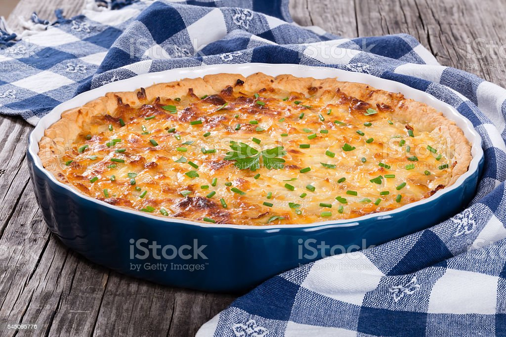 French onion quiche  or pie in a gratin dish stock photo