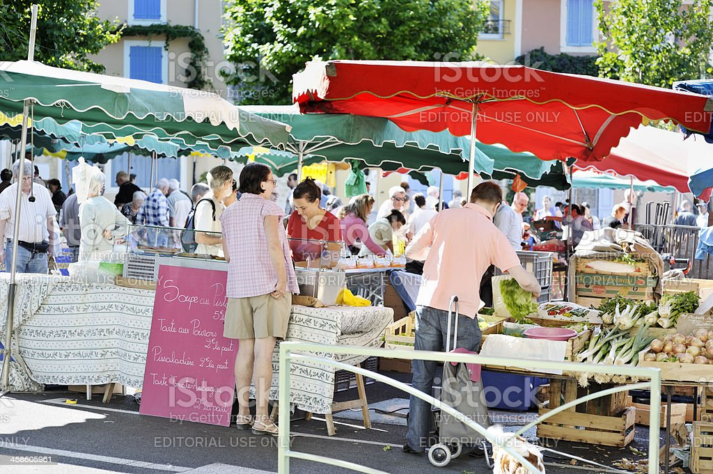 Busy French outdoor market in summer. Taken in Provence, which is...
