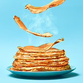 French pancakes is flying on the blue background