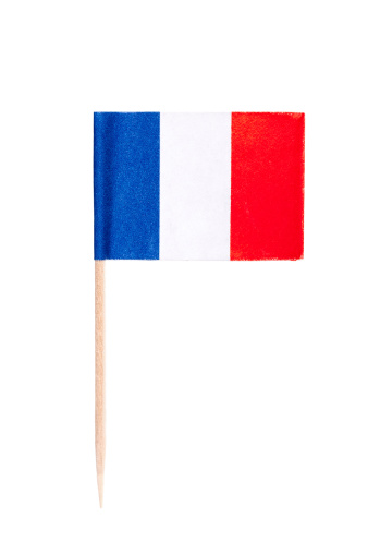 French paper toothpick flag. Nice paper texture. Isolated on white.