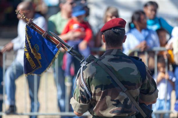 French Paratrooper Saint Denis, La Réunion - July 14 2016: Adjutant from the 2e RPIMa (régiment parachutiste d'infanterie de Marine) parading with the flag of his regiment during Bastille Day. adjutant stock pictures, royalty-free photos & images