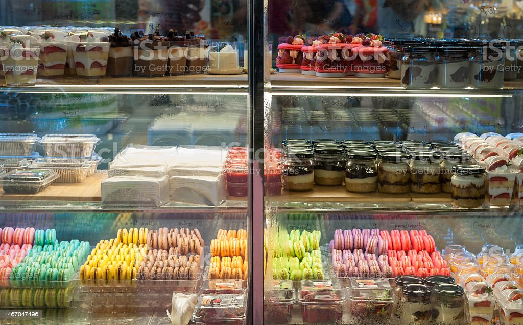 French pastries on display a confectionery shop. stock photo
