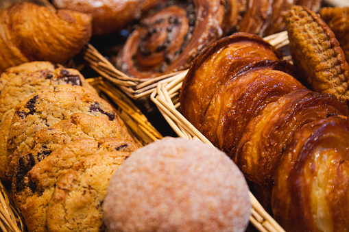 A variety of cakes and pastries on a boulangerie or patisserie market stall in Paris, France