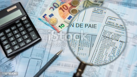 1217929357 istock photo French payroll with a calculator, euro cash, and a magnifying glass 1187953087