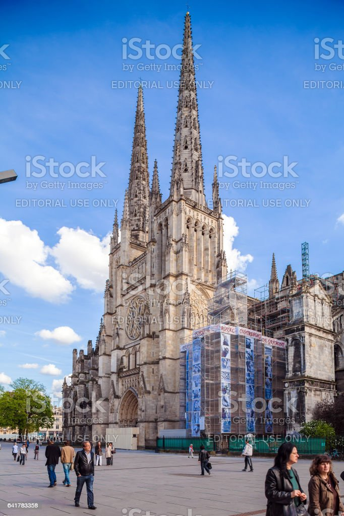 BORDEAUX, FRANCE - APRIL 4, 2011: French people walking near Saint Andre Cathedral (11th-15th c.) stock photo