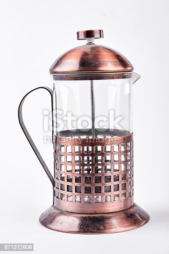 French press tea maker on white background. Vintage rusty press tea or coffee maker isolated on white background.